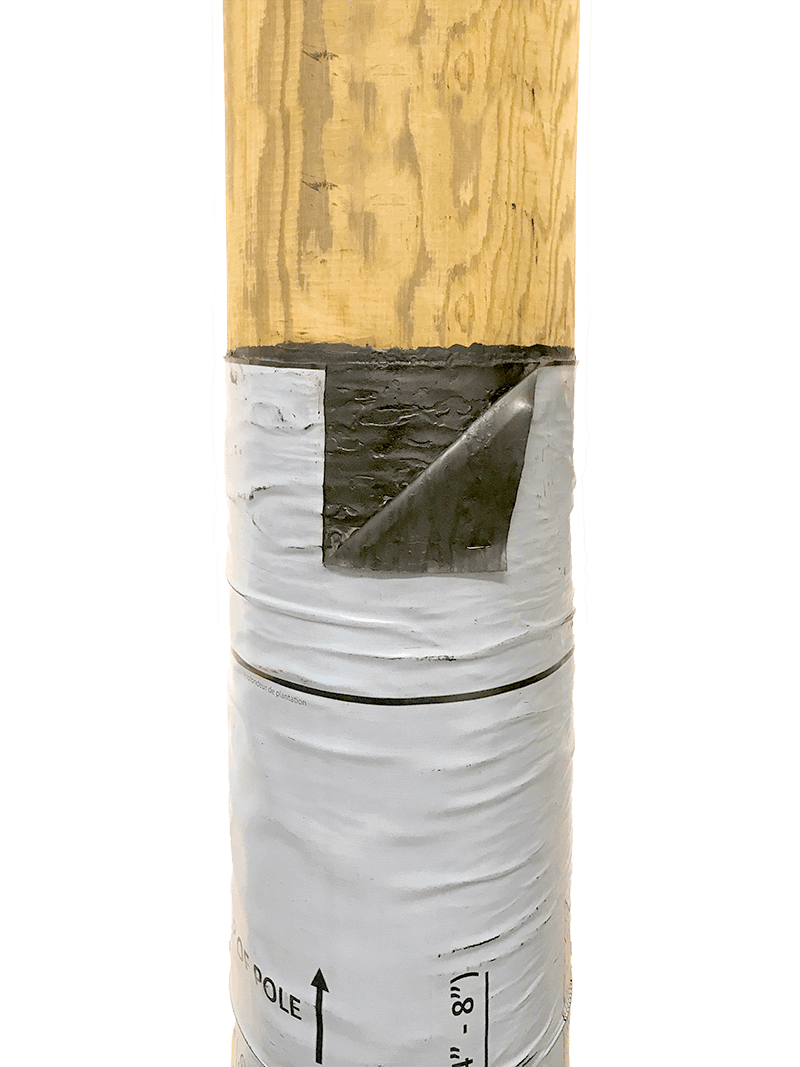 Image showing a cut-away of a Polesaver sleeve on a wooden utility pole